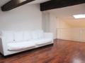 Galeriezimmer mit Couch