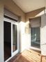 Balkon mit Tür zur Küche und zum Wohnzimmer