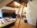 Schlafzimmer mit Galerie im Dachgeschoss