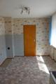Küche mit Zugang zur Garage und zum Kellergeschoss