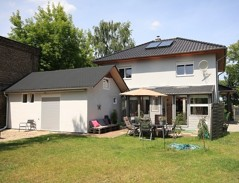 Großzügiges Einfamilienhaus mit Gewerbeeinheit und bester Ausstattung auf sonnigem Südgrundstück