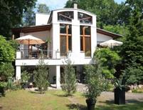 Spektakuläres Architekten-Einfamilienhaus mit Büro/Atelier und Einliegerwohnung in Spitzenlage
