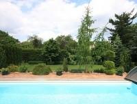 Sehr gepflegtes Traumgrundstück mit kleinem Wohnhaus, Pool, Saunahäuschen auf Südwestgarten