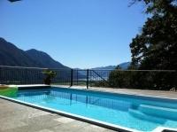 Neuwertige Villa mit Pool, Seesicht, Personenlift, Garage für 3 Autos, viel Privacy, 4 Sz, 3 Bäder