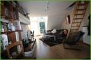 Wohnzimmer mit Zugang zum Spitzboden