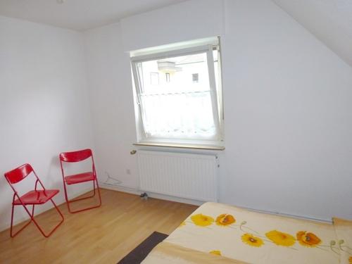 Schlafzimmer mit gemütlicher Dachschräge
