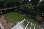 Blick vom Balkon in Garten