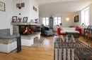 Wohnzimmer mit Natursteinkamin