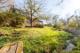 Haus Gartenansicht mit Bach 2
