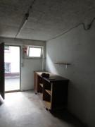 Werkstatt neben Garage