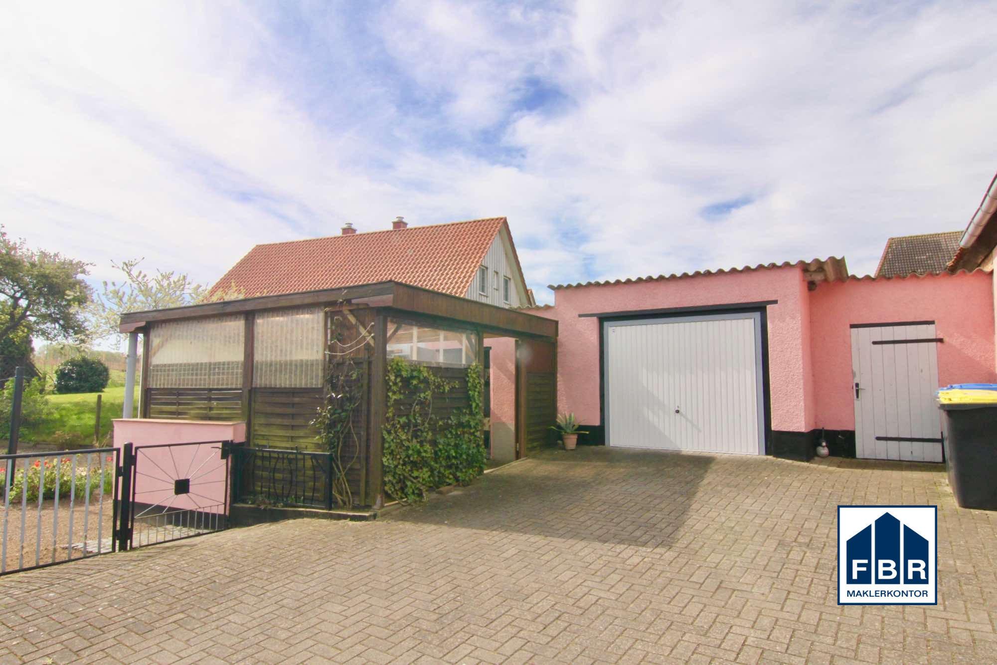 Garage + überdachte Terrasse