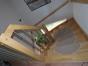 Treppenhaus mit massiver Holztreppe