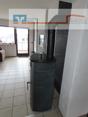 Wohnzimmer mit Ofen und Zugang Terrasse