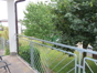 Balkon mit Wiesengrundstück