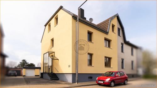 IVB#Ein-Zweifamilienhaus_mit_Garagen_und_großem_Garten_Aachen-Brand_Hausansicht