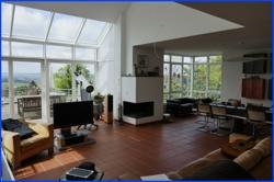 Living-mit-Wintergartenfront-und-Kamin-01-Verkauf-Einfamilienhaus-Ostbelgien