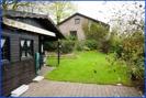 Blick-auf-Gartenhaus-und Haus-Belgien-Raeren-Verkauf-Einfamilienhaus-01