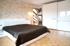 Schlafzimmer-mit-Blick-zum-Balkon