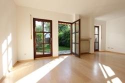 Wohnzimmer mit Zugang zum Westgarten