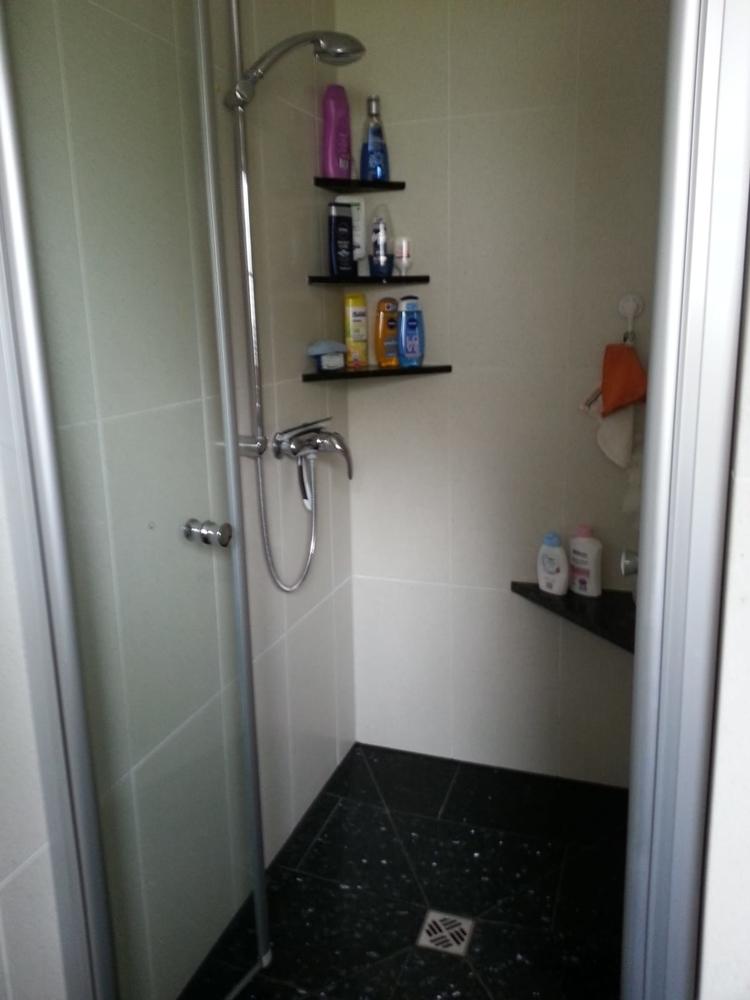 Erdgeschosswohnung - Badezimmer mit bodentiefer Dusche