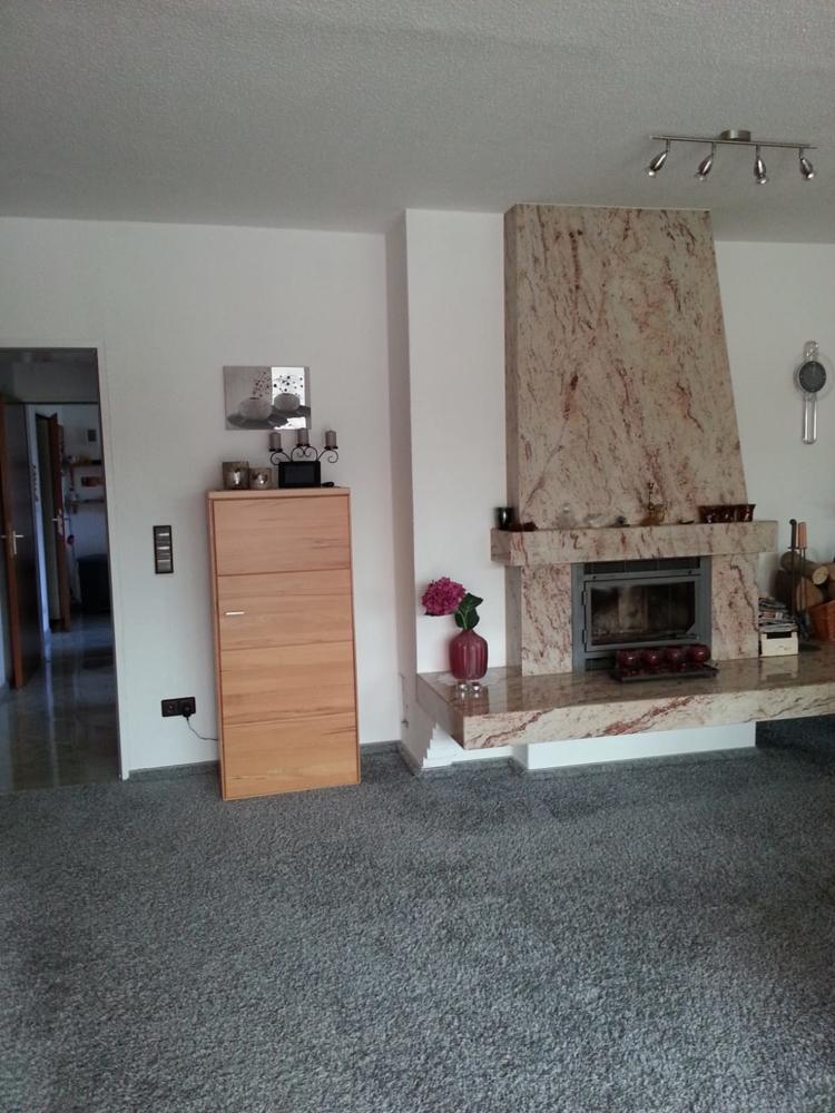 Erdgeschosswohnung - Wohnzimmer mit Kamin