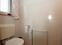 Gäste-WC - hell baujahrstypisch gefliesst
