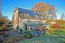 Rückwärtige Ansicht des Anwesens mit Terrassen und Photovoltaikanlage zur Brauchwassererwärmung