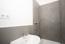 Das komplett sanierte. modern gestaltete Duschbad
