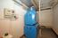Buderus G115 Ölheizkessel und Buderus Logalux Warmwasserspeicher (200 Liter) zur Wärmeversorgung des Wohnhauses und Warmwasserversorgung des Wohnhauses und der Schwimmhalle