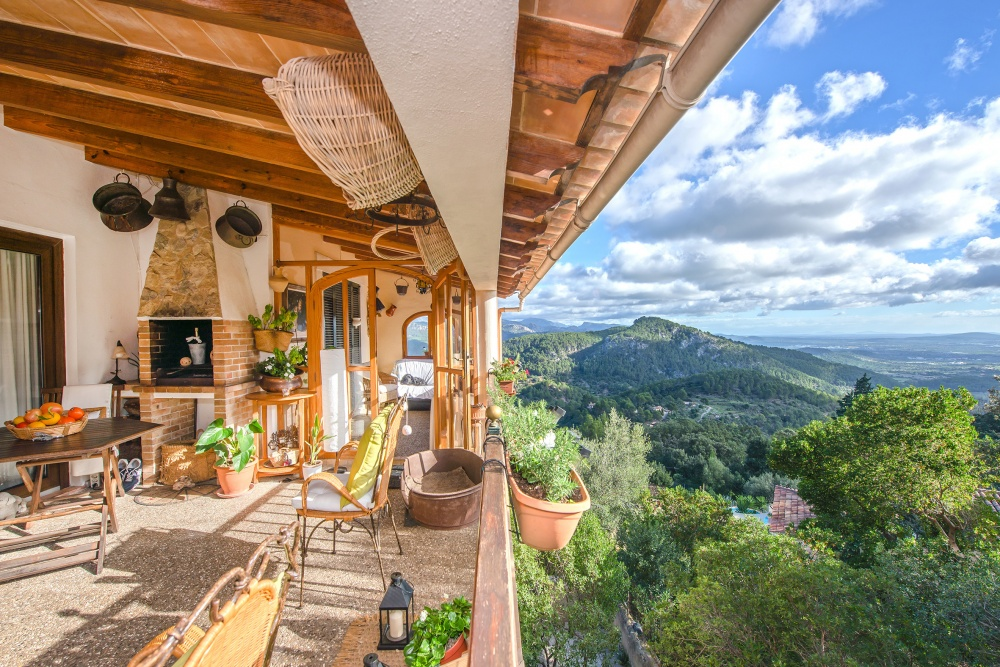 This Mediterranean house with breath-taking panoramic views to the bay of Palma is located in a unique natural setting of Es Verger, Esporles