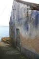 Side view stonehouse and sea