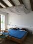 Schlafzimmer mit romantischem Meerblick