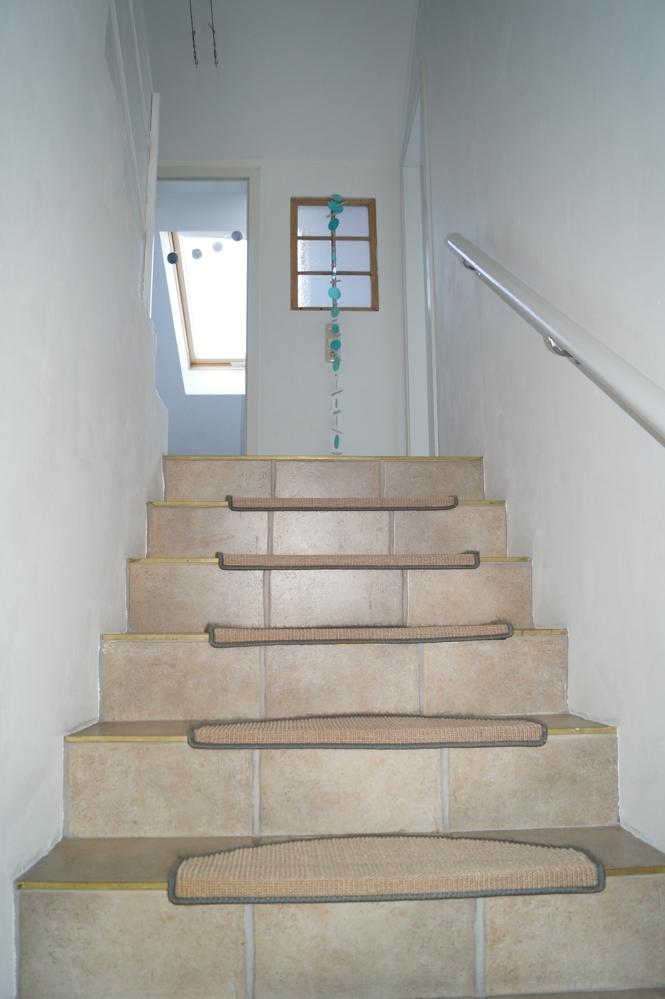 Treppe zum Badezimmer und Abstellraum im Obergeschoss