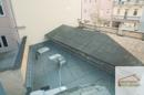 Blick auf das Dach des Teppichladens