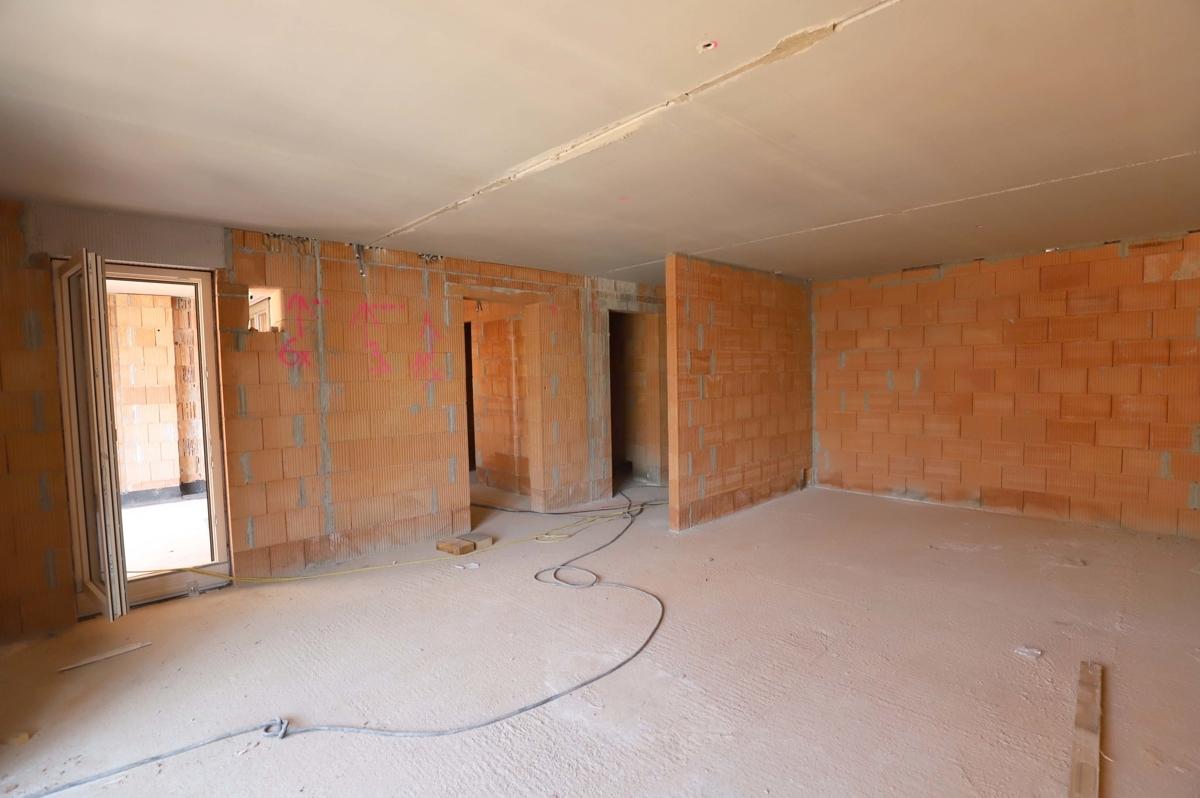 Küche, Essbereich und Zugang zu den Schlafzimmern