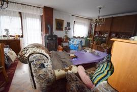 Wohnzimmer mit Specksteinofen