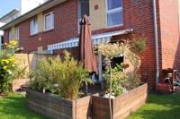 Reihenendhaus Gartenseite