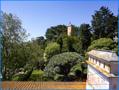 Dachterrasse mit Blick auf dem Glockenturm und in den Garten