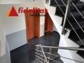 Das Treppenhaus DG zum OG des Neubaues mit Edelstahlgeländer