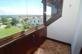 Kleiner verglaster Balkon