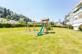 Gepflegte Gartenanalage, eigener Spielplatz