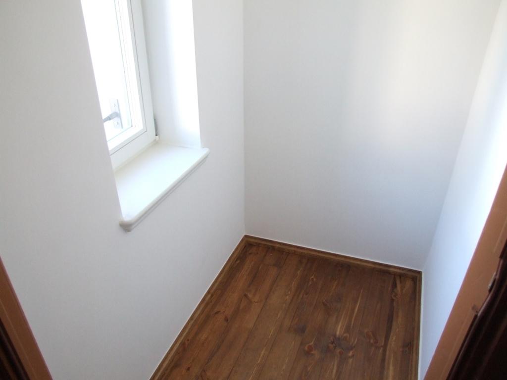 Abstellkammer auf halber Treppe